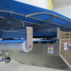 Troughed rod bed conveyor system